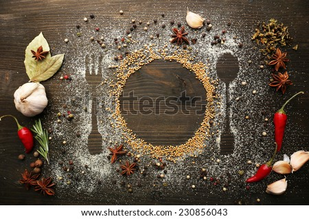 Spices on table with cutlery silhouette, close-up  Royalty-Free Stock Photo #230856043