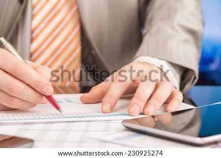 Businessman analyzing report #230925274