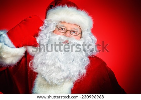 Close-up portrait of Santa Claus. Christmas time. Red background. #230996968