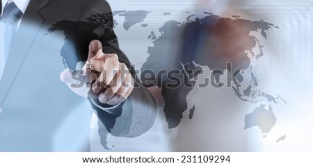 Double exposure of businessman hand working on world map on touch screen computer as concept #231109294