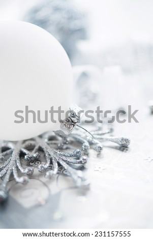 Silver and white christmas decoration on holiday background. Winter holidays. Xmas theme. #231157555