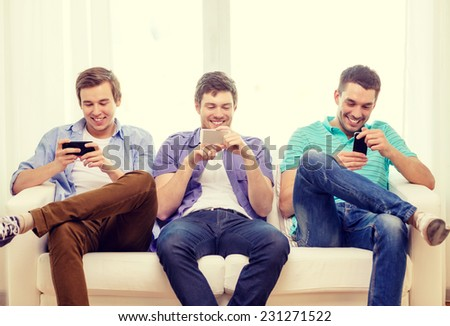 friendship, technology and home concept - smiling male friends with smartphones at home #231271522
