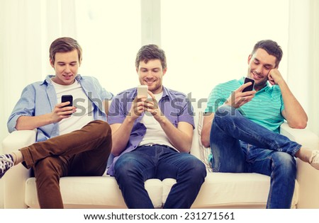 friendship, technology and home concept - smiling male friends with smartphones at home #231271561