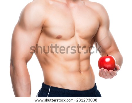Young man with perfect body holding red apple in his hand - isolated on white background. #231293008