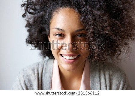 Close up portrait of a beautiful young african american woman smiling Royalty-Free Stock Photo #231366112