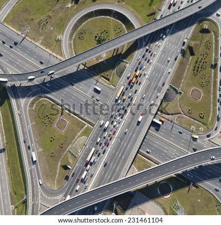 Aerial view of highway interchange of a city #231461104