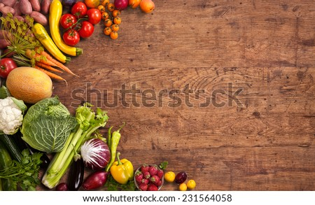 Healthy food background / studio photo of different fruits and vegetables on old wooden table  #231564058