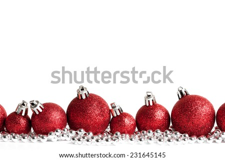 red christmas balls on white. studio shot