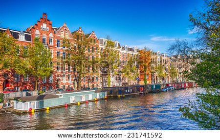 Amsterdam. Wonderful view of city canals and buildings in spring season. #231741592