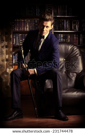 Respectable handsome man in his office. Classic vintage style. #231744478