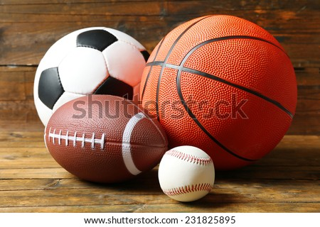 Sports balls on wooden background #231825895