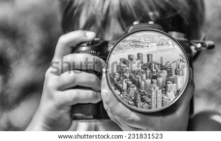 Young girl taking photos of New York by professional digital camera.
