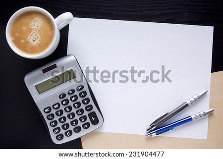 Office coffee with a calculator and office folders. #231904477