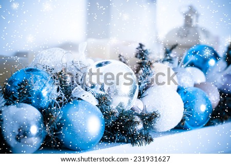Christmas composition with balls and decoration with snow and star. Blue toned #231931627
