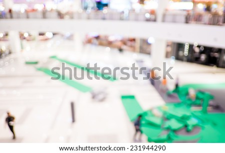 Blurred background : Staff set up the booth of event in department store  #231944290