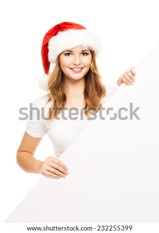 Young and attractive teenager girl with a blank billboard isolated on white background #232255399