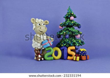 Clay sheep with gifts and numbers near the Chrismas tree