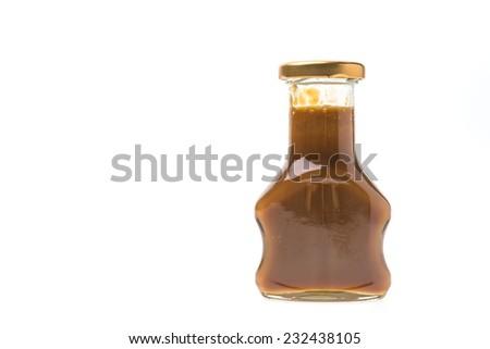 Caramel bottles sauce isolated on white background #232438105