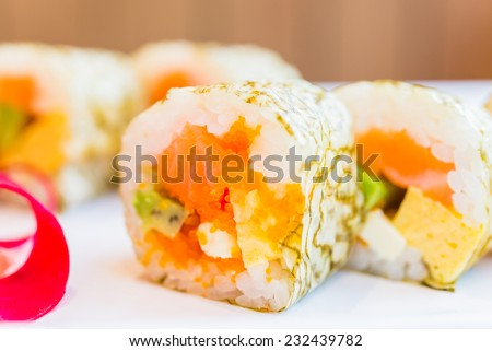 Salmon sushi roll maki - japanese food - selective focus #232439782