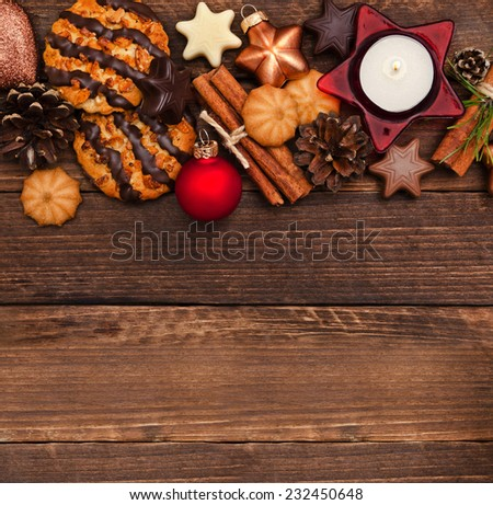 Christmas cookies with fir tree branches, balls and festive decor on the old wood background  #232450648