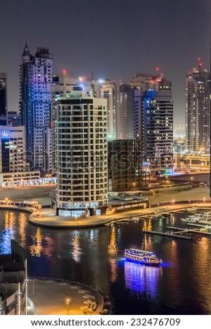 DUBAI, UAE - SEPTEMBER 29, 2012: Wonderful Night view of Dubai Marina. Marina - a district of Dubai along artificial canal, carved along a 3 km stretch of Persian Gulf shoreline. United Arab Emirates. #232476709