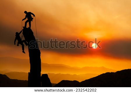 Climbers on the summit of a challenging cliff. #232542202