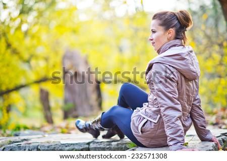 woman in autumn park #232571308