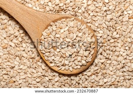 Organic natural sesame seeds on wooden spoon #232670887
