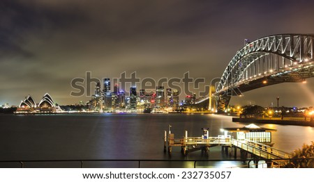 AUstralia Sydney CBD landmarks city skyscrapers and harbour bridge arch after sunset brightly illuminated from dwarf to circular quay Royalty-Free Stock Photo #232735057