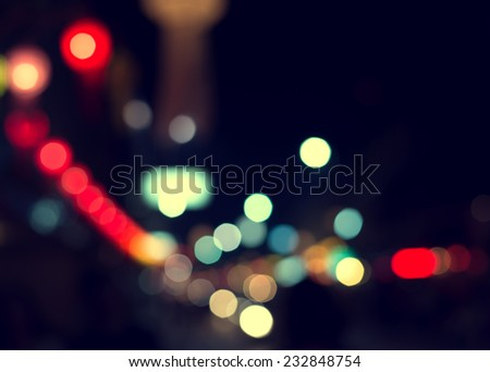 Artistic style - Defocused urban abstract texture ,bokeh of city lights in the background with blurring lights for your design, vintage or retro color tone #232848754