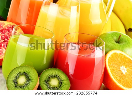 Composition with glasses of assorted fruit juices. Detox diet Royalty-Free Stock Photo #232855774