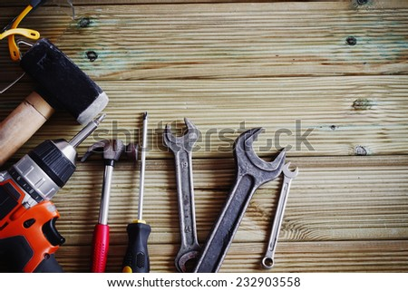 different tools on a textured wooden background. copy space background #232903558