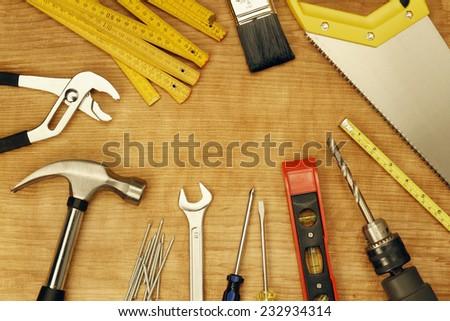 Assorted work tools on wood #232934314