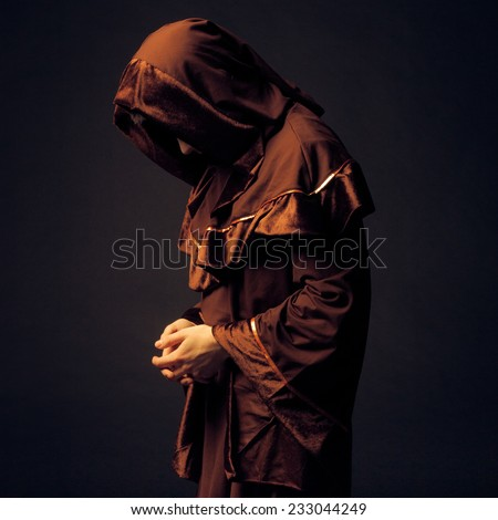 mysterious Catholic monk on dark background. studio shot #233044249