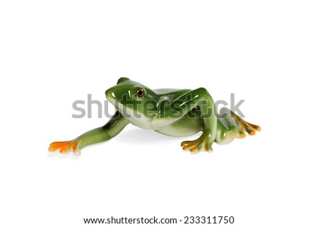 Glass figurine green frog crawling side view isolated on white background #233311750