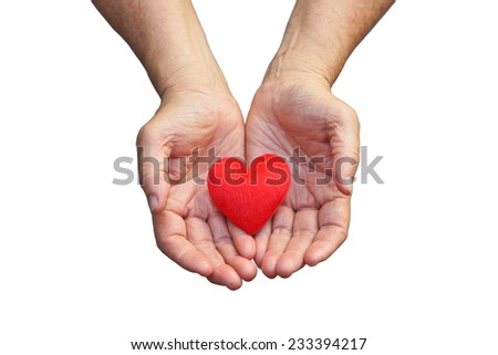 old hands of the elderly giving a red heart #233394217