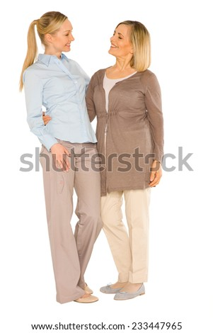 smiley grandmother and young mother standing on white background #233447965