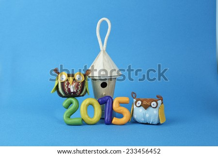 Owls with the bird house and numbers 2015