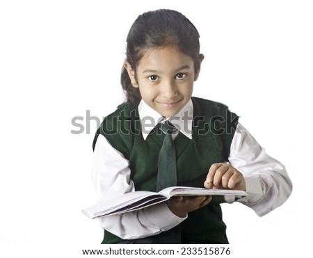 A sweet school girl taking teacher,s note from blackboard