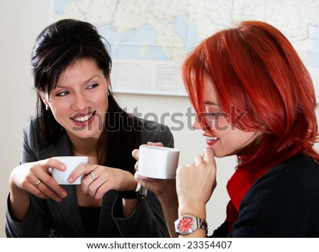 two young caucasian businesswoman in the office #23354407