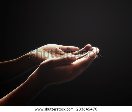 Meditation concept: Muslim prayer open two empty hands with palms up for pray in black room background #233645470