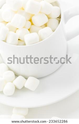 Small round white marshmallows on a white backgrouns. #233652286