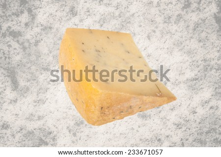 triangular piece of cheese with herbs isolated on granite background #233671057