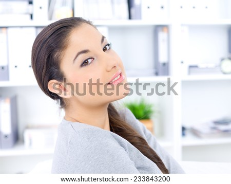 Close up Pretty Long Hair Woman Smiling at the Camera Inside the Office with Shelves Background. #233843200