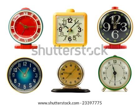 Vintage mechanical wind-up alarm clocks on white background #23397775
