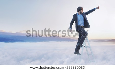 Successfull businessman reaching the top #233990083