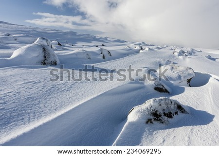 Snowdrifts in South Iceland.Close to Reykjavik city/Winter mountain snow drifts  #234069295