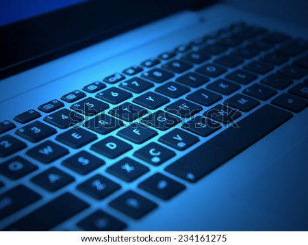 white laptop keyboard with black keys closeup #234161275