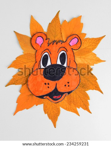 Autumn leaves with painted lion close-up