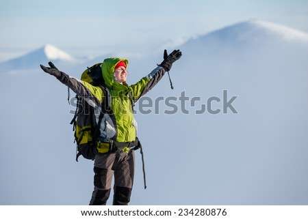 Backpacker woman posing in winter mountains #234280876